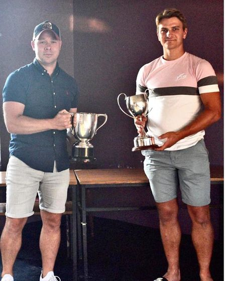 Nathan Dawes and Harry Hunt show off the Challenge Cup and Knockout Cup, both won by Skew Bridge