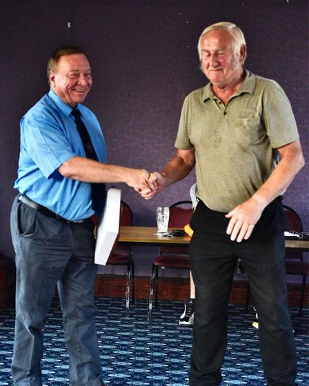 Brian Wright (right) presents a special award to referee Steve Trulock for 45 years service