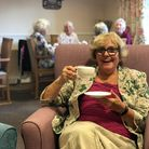 Elderly woman with coffee cup