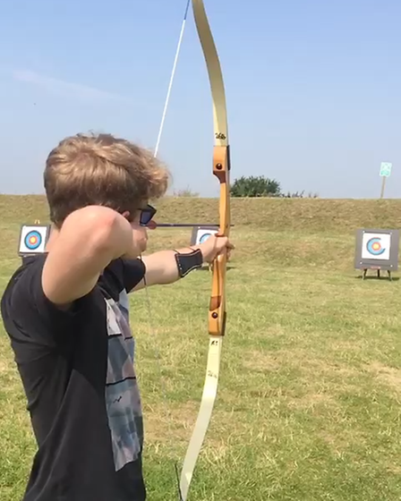 Jonathan Light taking part in archery at Essex Outdoors Bradwell.