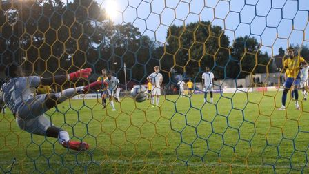 St Albans City's Shaun Jeffers sends his winning penalty against Watford straight down the middle