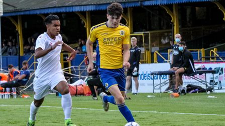 Alex Lankshear on the charge for St Albans City against Watford.