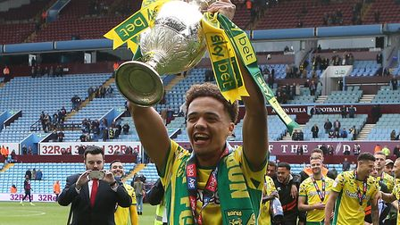 Jamal Lewis celebrates with the Championship trophy at Villa Park in 2019 Picture: Paul Chesterton/F