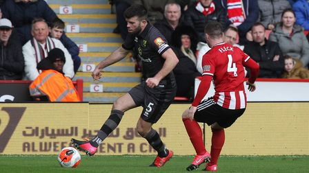Grant Hanley of Norwich and John Fleck of Sheffield United in action during the Premier League match