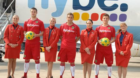 Norwich City players Darren Huckerby, Jason Shackell and Chris Martin model the club's new Flybe spo