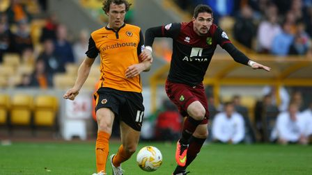 Kyle Lafferty of Norwich and Kevin McDonald of Wolves in action during the Sky Bet Championship matc