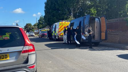 Forensic Services preparing to enter Patricia Holland's house in Gorleston.