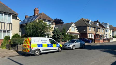 Forensic Services van outside house of Patricia Holland