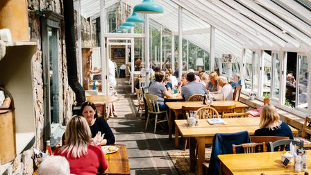 Sit inside the glasshouse overlooking the walled gardens at Applestore Cafe