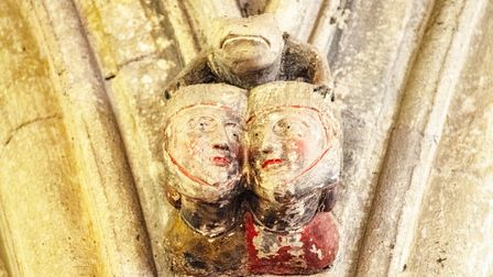 The toad! Cuddling up on this corbel with two gossiping women