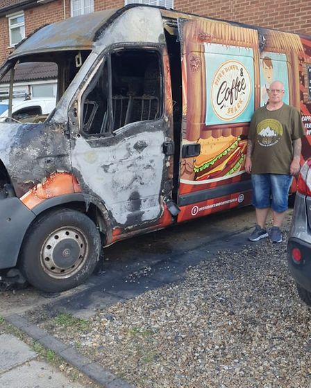 Mark Dyer in front of burned-out burger van in Chantry, Ipswich.