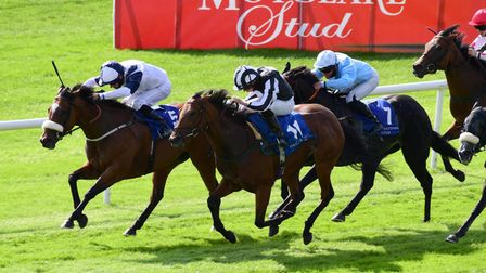 Glass Slippers ridden by jockey Tom Eaves (left) wins the Derrinstown Stud Flying Five Stakes race at Curragh Racecourse