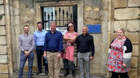 Cllr Sam Hoy (right) shows council delegation the finer points of Wisbech Castle