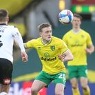 Lewis Wing of Rotherham United and Oliver Skipp of Norwich in action during the Sky Bet Championship