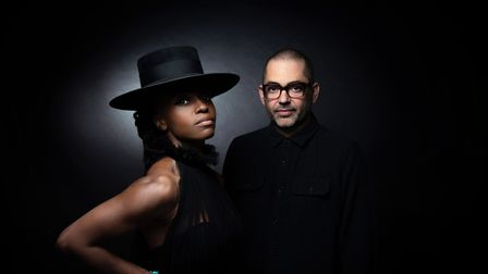 The rock band Morcheeba pictured against a black background.