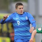 Ireland's Joe Hodge and Christos Tzolis of Greece pictured during the 2019 UEFA European Under-17 Ch