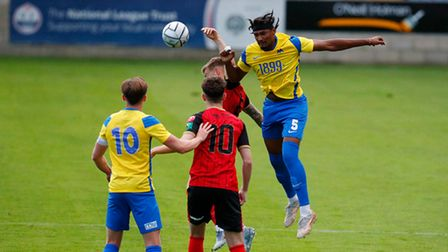 Ali Omar of Torquay United wins the aerial challenge against Andrew Neal of Truro City during the pr