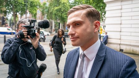 Lewis Hughes, 23, arrives at Westminster Magistrates' Court in London, where he is charged with comm
