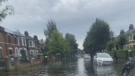 A flooded road in Forest Gate.