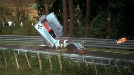 """LE MANS - JUNE 23: A racing scene from the movie """"Le Mans"""", 1971. Shown is car number 20, a 1970 Po"""