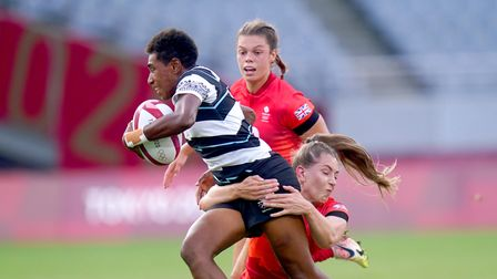 Helena Rowland looks on asFiji's Reapi Ulunisau is tackled by GB team-mate Holly Aitchison