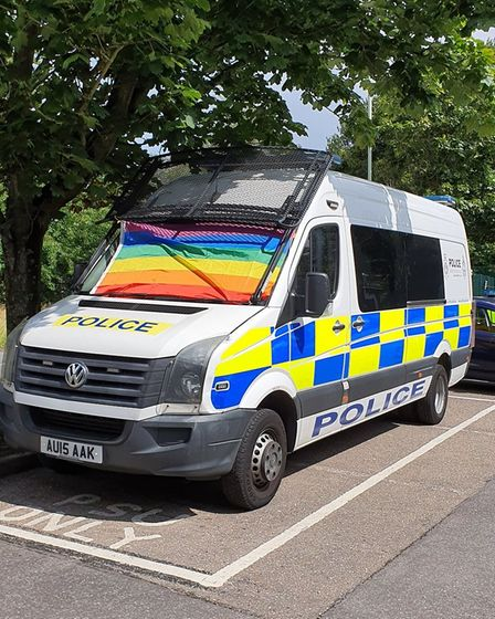 A Norfolk Police vehicle displaying a Pride-inspired flag for Norwich Pride.