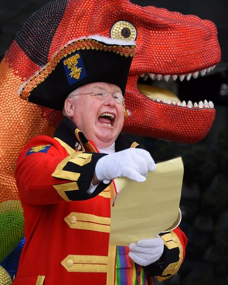 Pride town crier, Mike Wabe, launches Norwich Pride with a special cry by the GoGoDino Prideosaurus