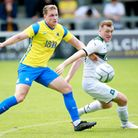 Jacob Evans of Torquay United battles for the ball with Luke Jephcott of Plymouth Argyle during the