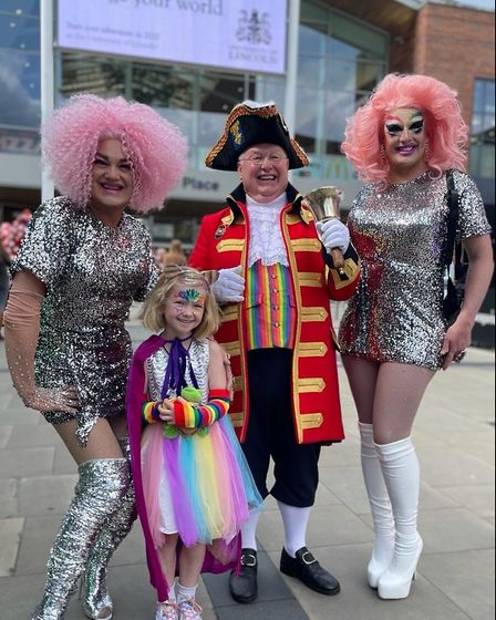 Norwich Pride town crier Mike Wabe with The Squirrels and a young visitor to the city for Norwich Pride 2021.