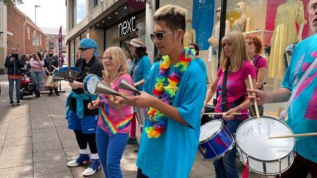A samba band performing in the city centre for Norwich Pride 2021.