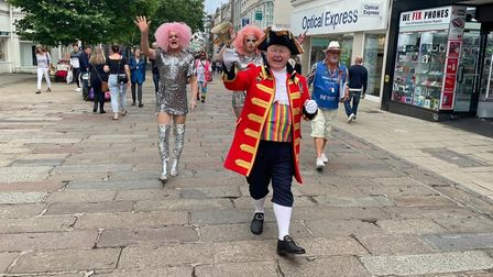 Norwich Pride town crier Mike Wabe walking through the city centre for the 2021 celebrations.