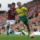 Frederic Guilbert of Aston Villa and Todd Cantwell of Norwich in action during the Premier League ma
