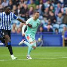 Sheffield Wednesday's Dominic Iorfa and Huddersfield Town's Oliver Turton battle for the ballduring