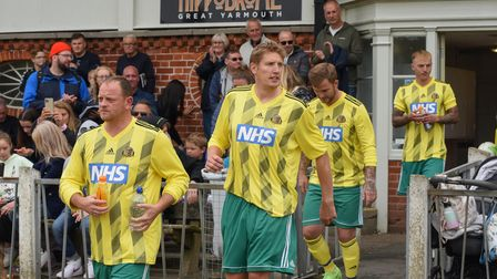 NHS staff heading onto the pitch at Wellesley Recreation Ground in Great Yarmouth to play against NC