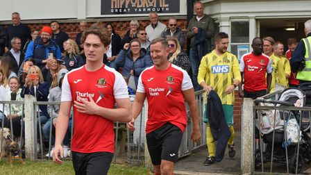 NCFC legends heading onto the pitch at Wellesley Recreation Ground in Great Yarmouth to play against