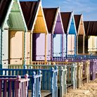 THE NEW BEACH HUTS AT WEST MERSEA, ESSEX, ALL PAINTED IN PASTEL COLOURS