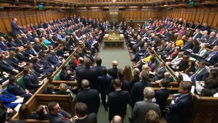 Members of Parliament sit during Prime Minister's Questions in the House of Commons. Photograph: Hou
