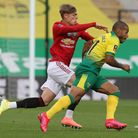 Brandon Williams of Manchester United and Onel Hernandez of Norwich in action during the FA Cup quar