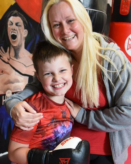 Eight-year-old Xander Waldrom at boxing training with his mum Briony Thompson. Picture: DENISE BRADL