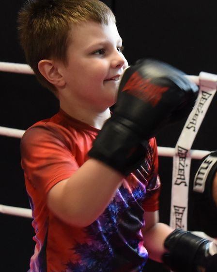 Eight-year-old Xander Waldrom, who has autism, but is benefitting from boxing training. Picture: DEN