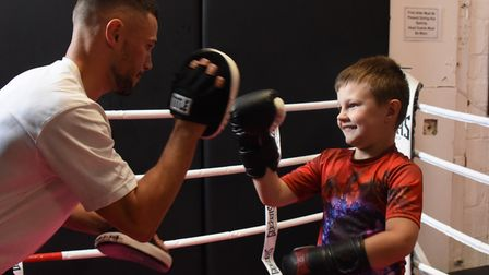 Eight-year-old Xander Waldrom, who has autism, but is benefitting from his boxing training with his