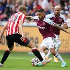 West Ham United's Manuel Lanzini (right) takes on Brentford's Mads Roerslev Rasmussen during the pre