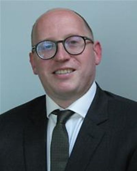 A man wearing round glasses, smiling: Cllr George Smith (The Sampfords - Conservatives)