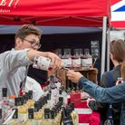 women doing gin tasting at a stall