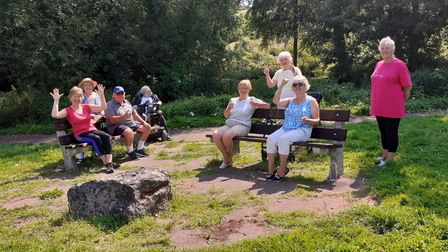 The regular fitness group test out the newly repaired benches.