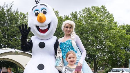 Olaf and Elsa from the film Frozen meet a fan on The Common, Saffron Walden, Essex
