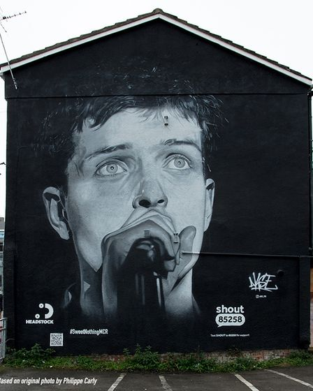 Manchester artistAkse P19 mural of Joy Division's Ian Curtis.