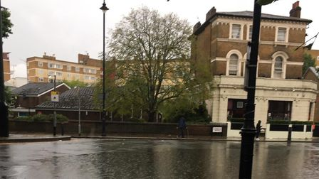 Cambridge Gardens in Kilburn under water after downpour on July 12