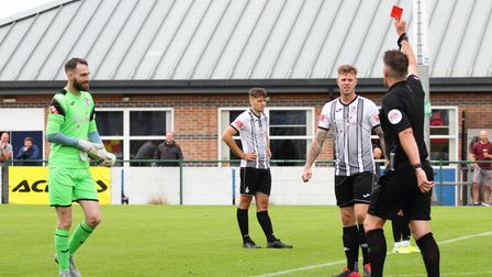 St Ives Town goalkeeper Paul White is shown a red card in the game at St Neots
