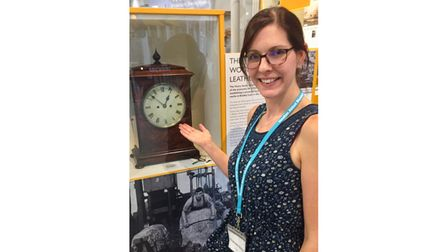 Museum worker with antique clock